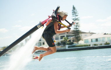 Woman flying in the air on flyboard