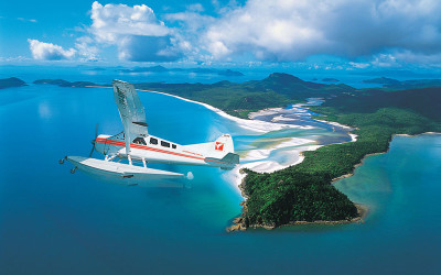 Seaplane flying over Whitehaven Beach, Whitsunday Islands