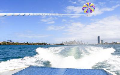 Couple tandem parasailing over the Gold Coast
