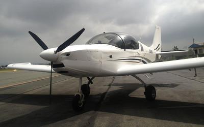 Small aircraft on tarmac