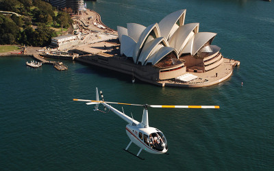 Helicopter flying over Sydney Opera House