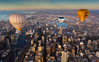 Hot air balloons flying over Melbourne city