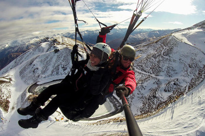 Tandem paragliding over Queenstown in winter