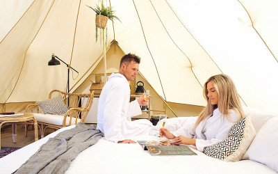 Couple inside glamping tent