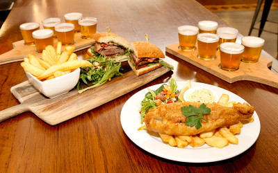 Pub meal with beer tasting paddles