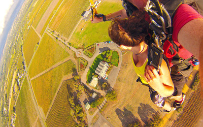 Woman and man tandem skydiving over McLaren Vale