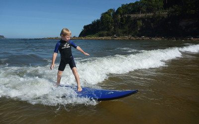 Kids learn to surf lesson