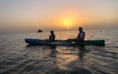 Couple kayaking at sunrise at the Great Barrier Reef