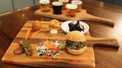 wooden tasting board with burger and beer
