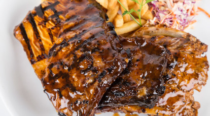 plate of ribs chips and fries