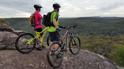 two cyclists looking over national park