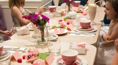 The tea salon childrens high tea party with pink cakes sweets and tea cups