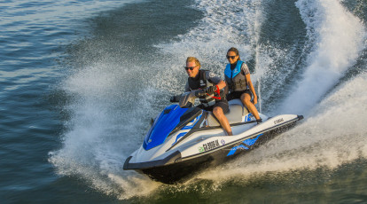 couple riding on jet ski in the ocean