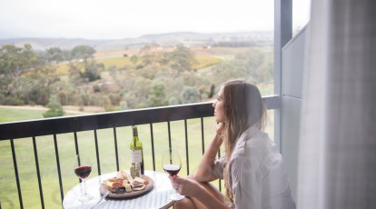 woman in balcony overlooking barossa valley
