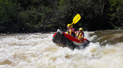 raft with two people paddling through yarra river
