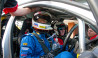man and instructor in v8 race cars on symmons plains track