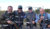 Hitting Targets clay target shooting with live ammo group of men