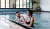 Grange Bellinzona couple enjoying indoor pool