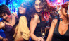 vagabond cruises women dancing on dancefloor with champagne coloured lights