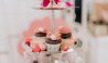 The Tea Salon high tea cupcake tray display with rose petals