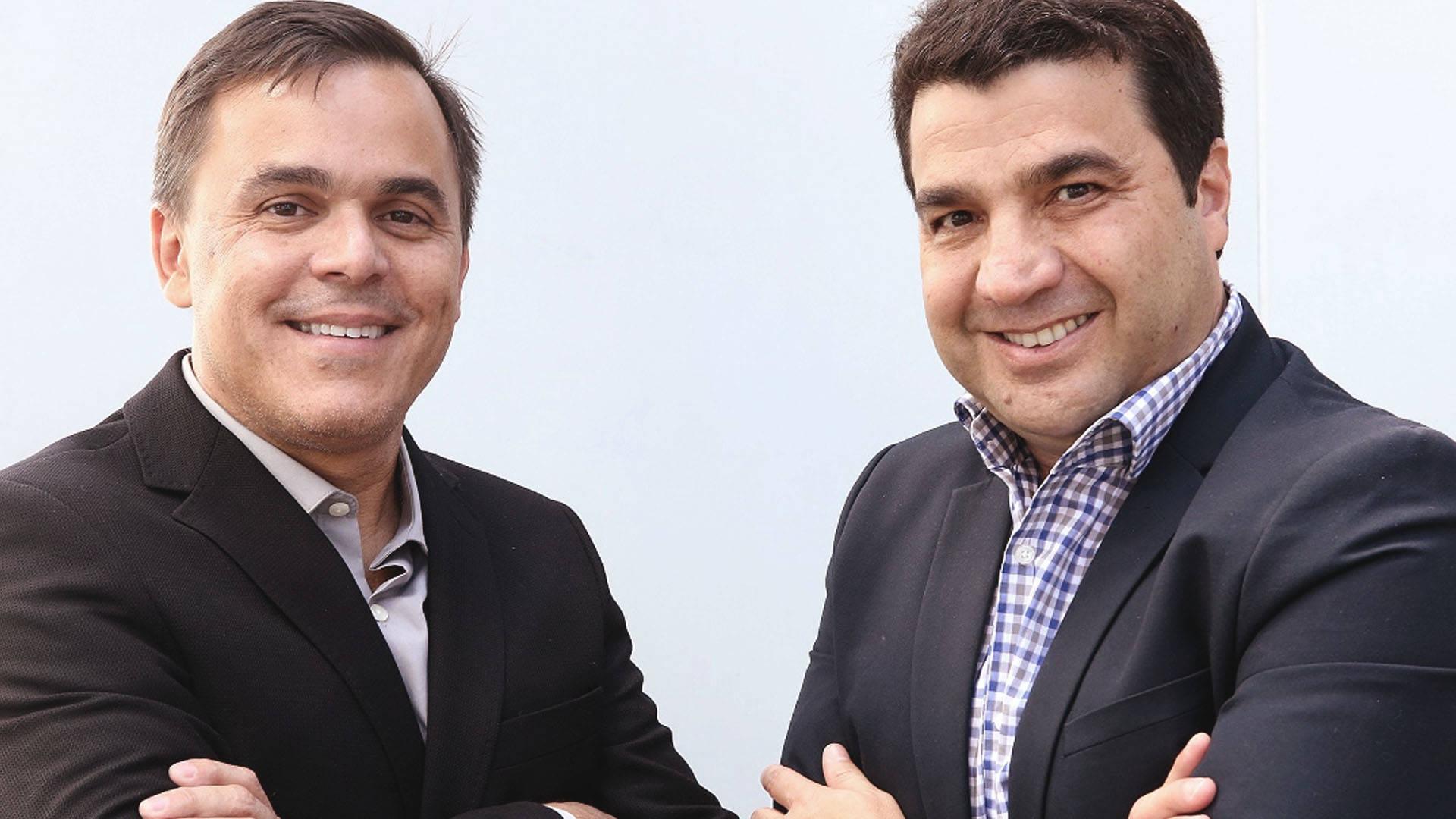 Pierre Schurmann e João Kepler, da Bossa Nova Investimentos, fecham negócio com o Grupo BMG