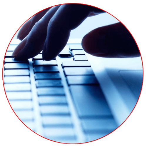 Fingers on a keyboard of a laptop