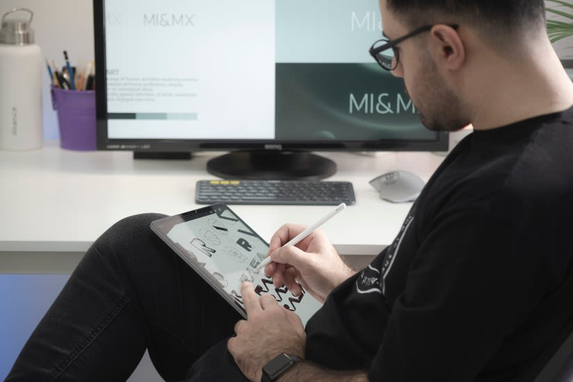 Man doing logo design on tablet