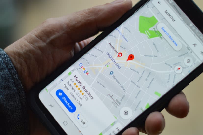 phone showing image of google map pinpointing to a business