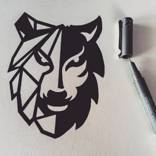 Drawn draft of a logo for a business. Logo is a wolf with one side shaded and the other side made from geometric lines.
