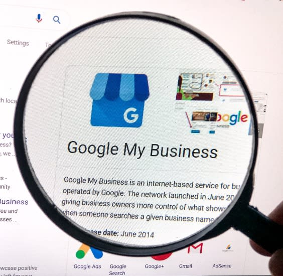 magnifying glass over computer screen highlighting Google My Business