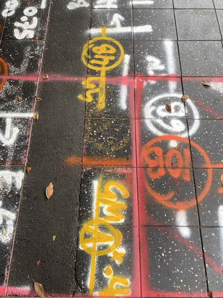 Utility graffiti + Monga Khan on Church / Red Wolf