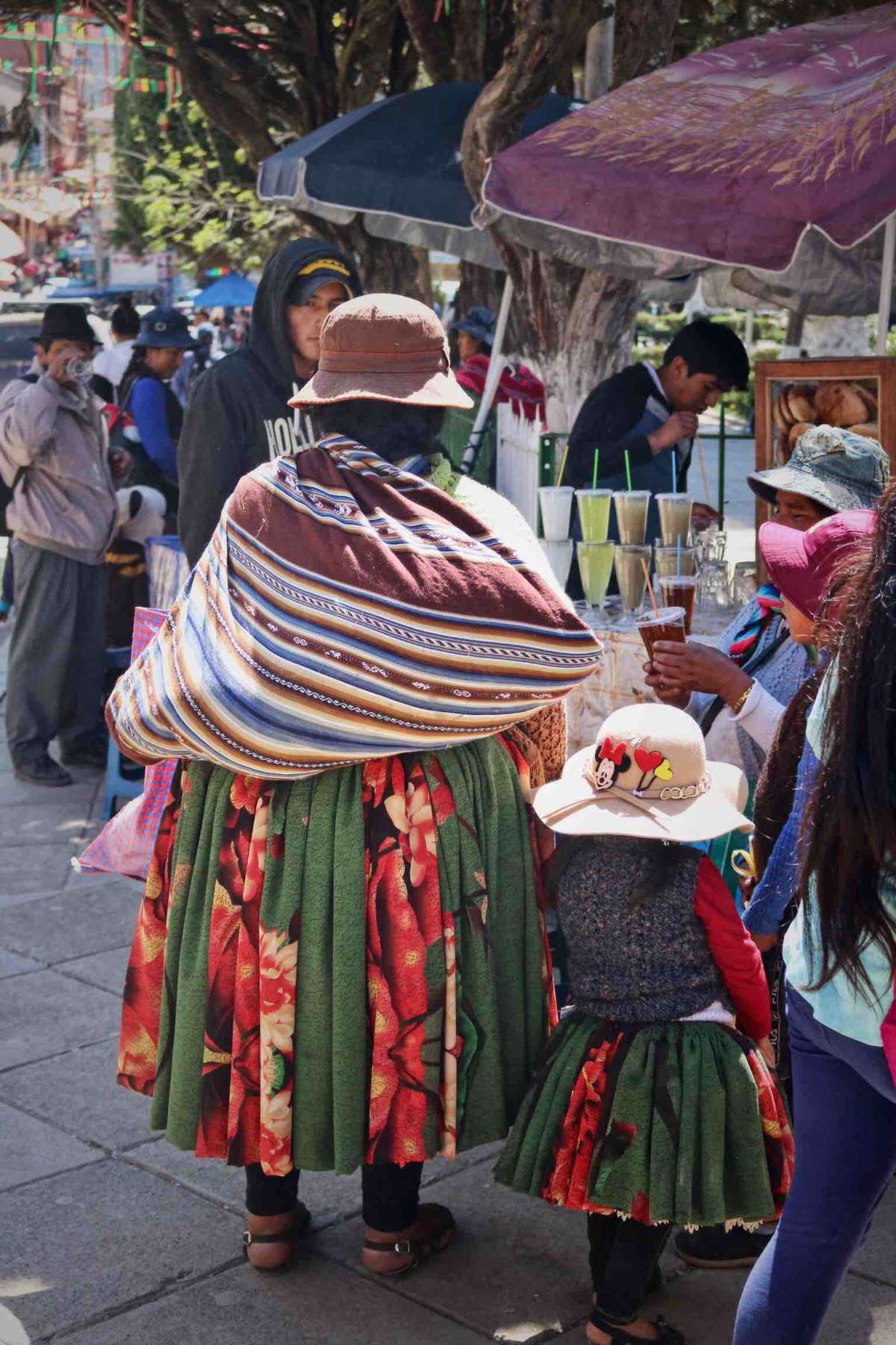 There is no age that one 'becomes' a cholita. Learning the customs from her mother often starts from an early age.