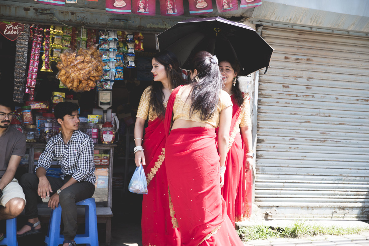 Nepalese women in their traditional red dresses