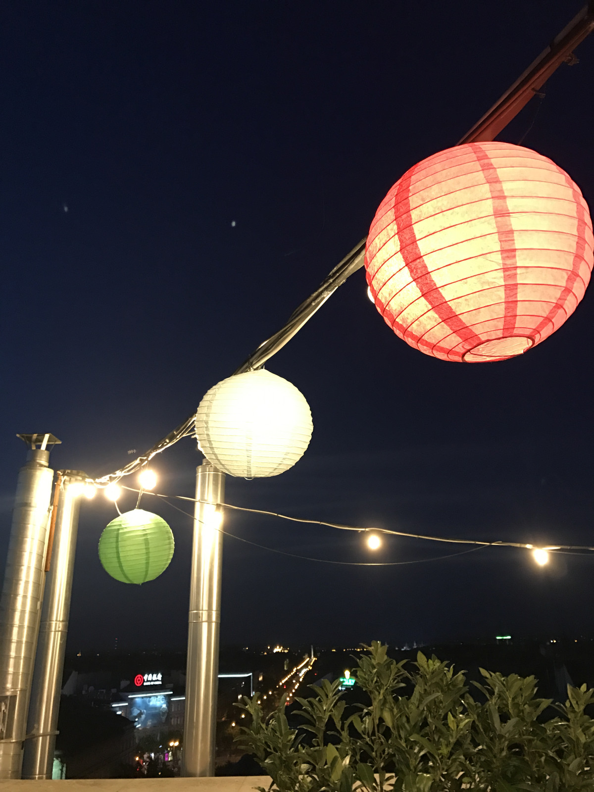 The rooftop was lit with pretty lanterns and fairy light