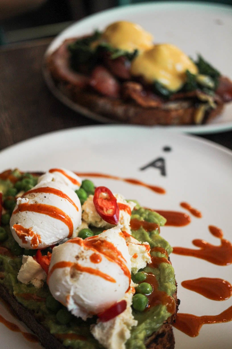 Smashed avocado, Persian feta, poached eggs, chilli, peas and mint on grilled sourdough