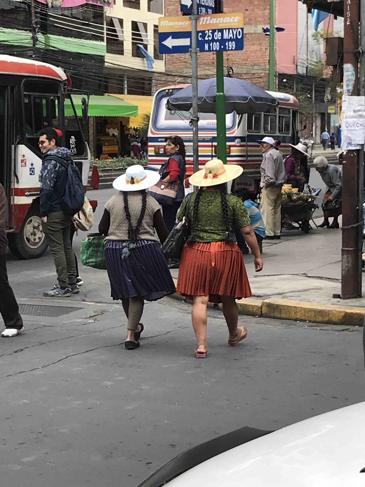 Racy cholitas in Cochabamba with their short skirts and sunhats.
