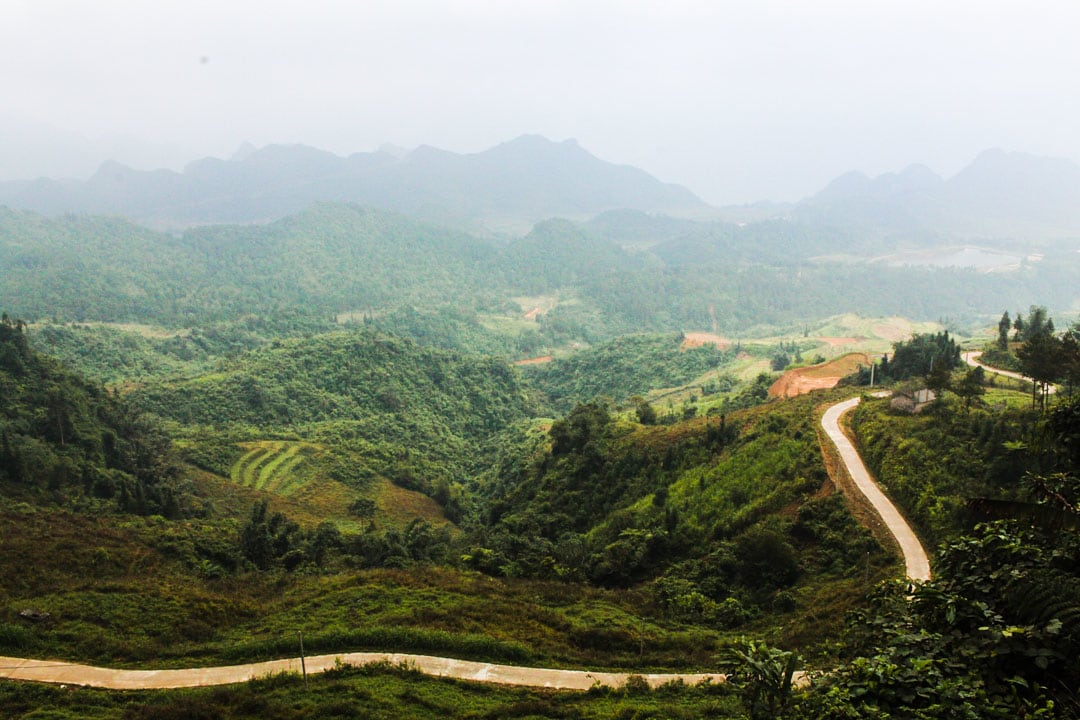 Tiny beautiful road among lush mountains.
