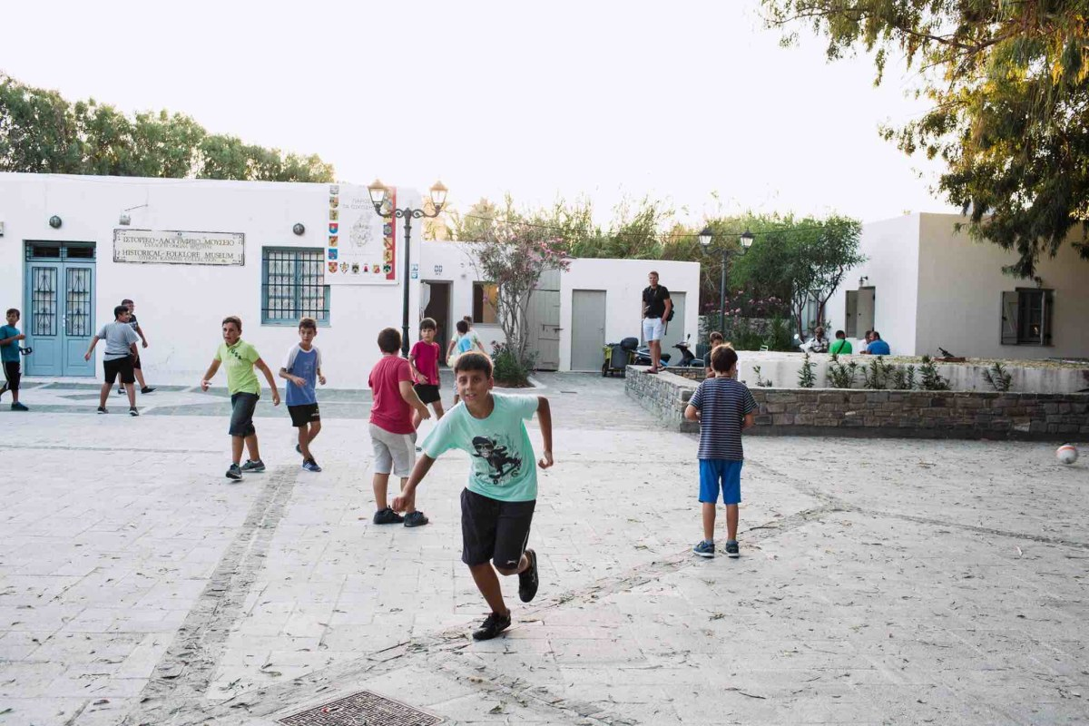 A perfect end to our week in Paros. My son playing soccer with local kids.