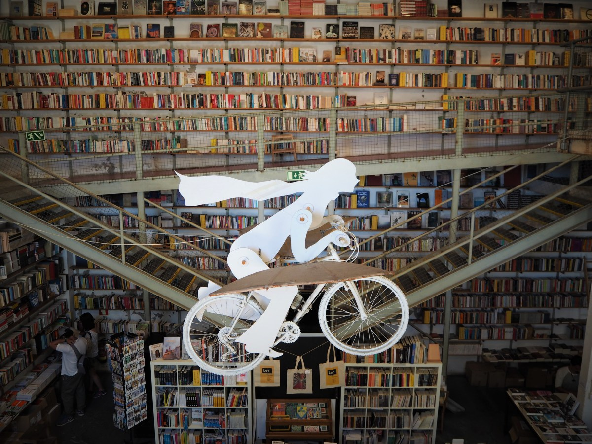 \x22Ler Devagar\x22 bookstore and its flying bicycle.