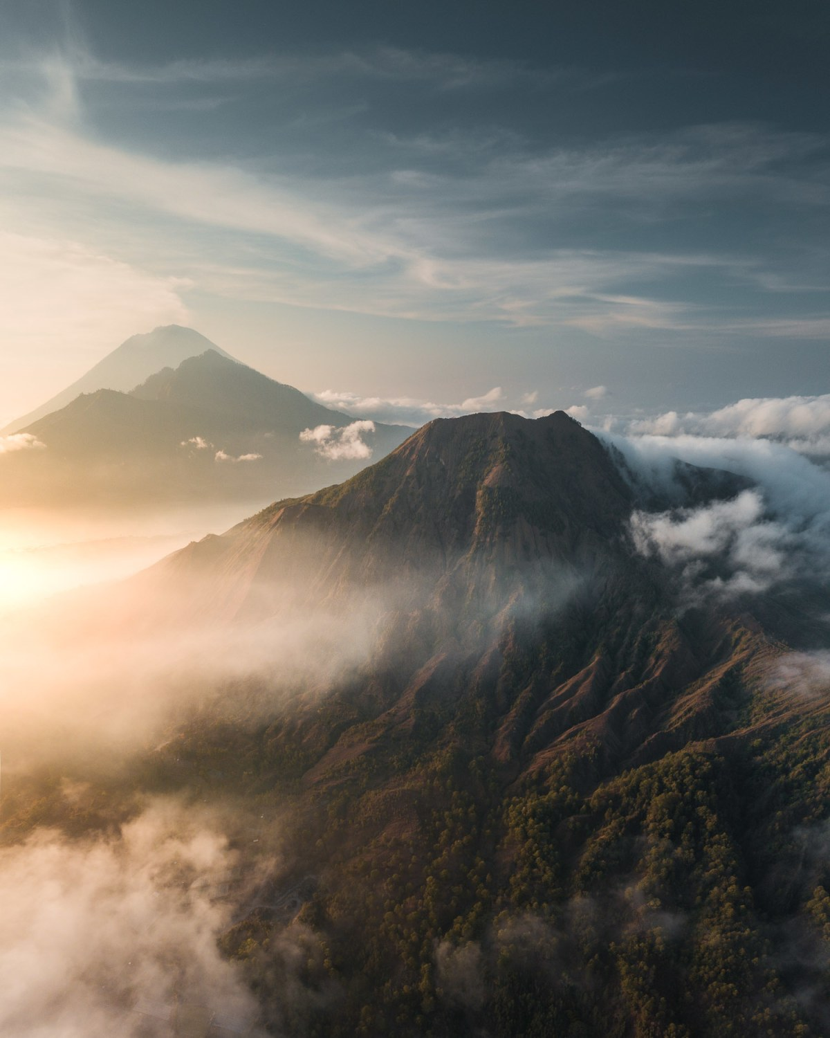 Pinggan views of morning light with clouds, volcanic sights and wild colours