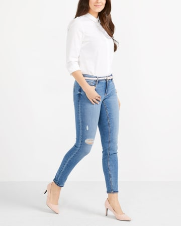 The Petite Insider Light Wash Skinny Jeans