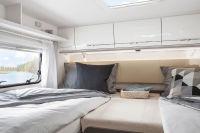 wahlweise als Doppelbett oder mit zwei Handgriffen zu einem Kingsizebett umgebaut (2x2 Meter)