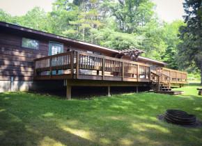 Cabin exterior at Tri Lake Timbers Resort.