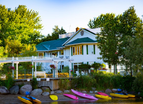 Elmhirst's Resort main building view from Rice Lake waterfront.