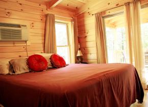 Cabin bedroom at ACE Adventure Resort.