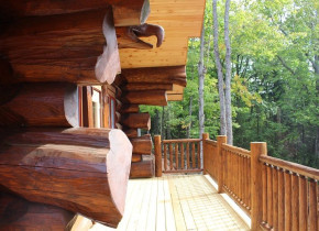 Cabin porch at Aqua Log Cabin Resort.