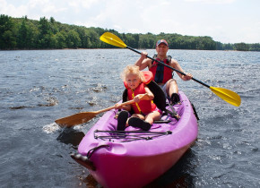 Family kayaking at Spicer Green Lake Resort.