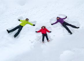 Kids making snow angels at Fairmont Le Chateau Montebello.