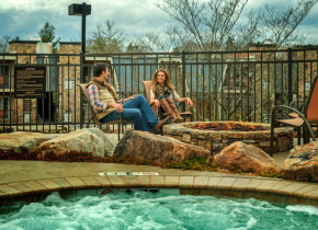 Couple by the pool at The Residences at Biltmore.