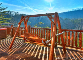 Cabin bench swing at American Patriot Getaways, LLC.